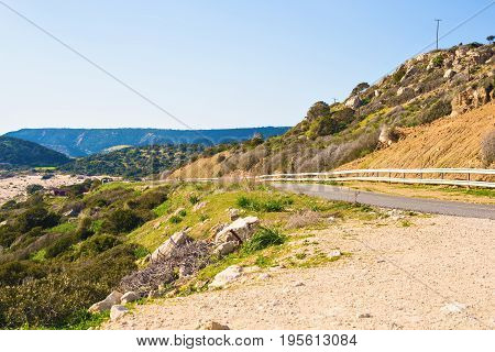 country road winding. Road up hill with green grass