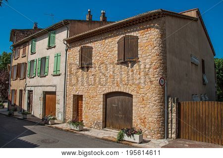 Figanières, France - July 11, 2016. View of street houses in the morning sun with blue sky, in the quiet and charming village of Figanières. Var department, Provence region, southeastern France
