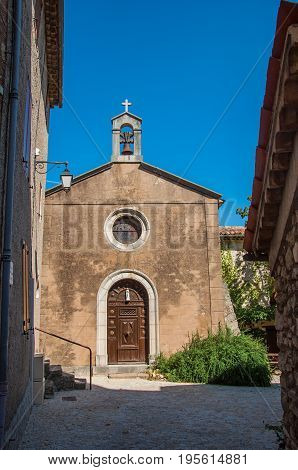 Figanières, France - July 11, 2016. View of the front church facade in the morning sun, in the quiet and charming village of Figanières. Var department, Provence region, southeastern France