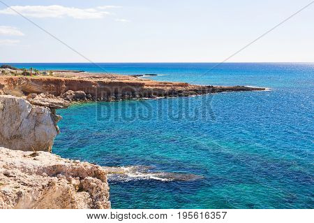 Rock cliffs and sea bay with azure water near Protaras, Cyprus island