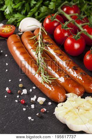 Wiener Sausages On Black Background.