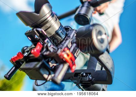 Video Camera Stabilization System. Video and Film Production DSLR Equipment.