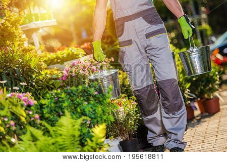 Floristry Industry. Floral Store Business. Store Worker Taking Care of Flowers.