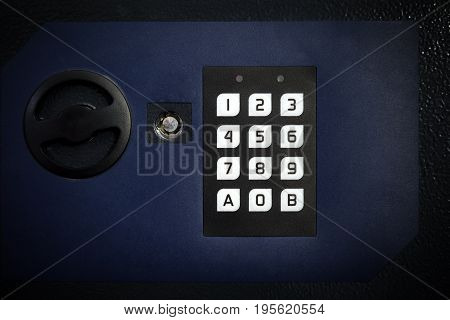 Closeup electronic secure safe for protection of money and documents in home or hotel room