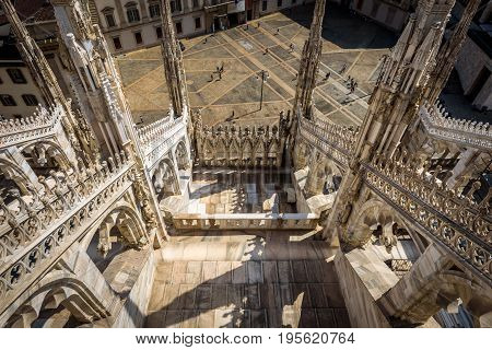 The terrace of the Milan Cathedral (Duomo di Milano) in Milan, Italy. View from rooftop. Milan Duomo is the largest church in Italy and the fifth largest in the world.