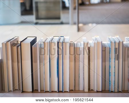 Book on bookshelf study in Library Education concept