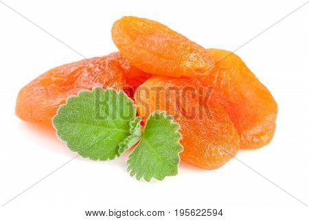 Dried apricots with mint leaves isolated on white background.