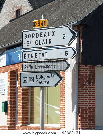 Editorial Les Loges, France - July 07, 2017: Street signs showing directions and distances in kilometer in Les Loges in Normandy, Northern France.