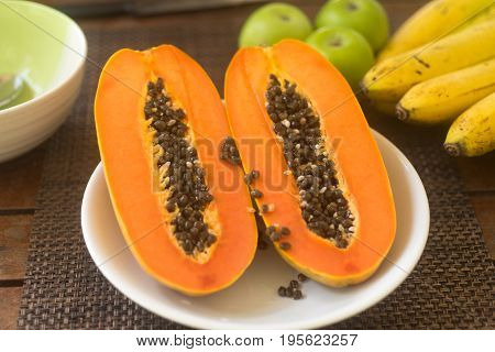 Veggies breakfast preparation use papaya and yogurt