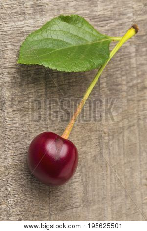 the fresh cherries on the  wooden table