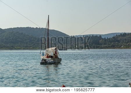 NYDRI, LEFKADA, GREECE -  JULY 17, 2014: Boats at Port of Nydri Bay, Lefkada, Ionian Islands, Greece
