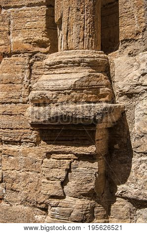 Close-up of old stone column base in Châteaudouble, a quiet and tourist village with medieval origin on a sunny summer day. Located in the Var department, Provence region, southeastern France