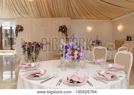 Wedding guest table decorated with bouquet and candles, ready for guests