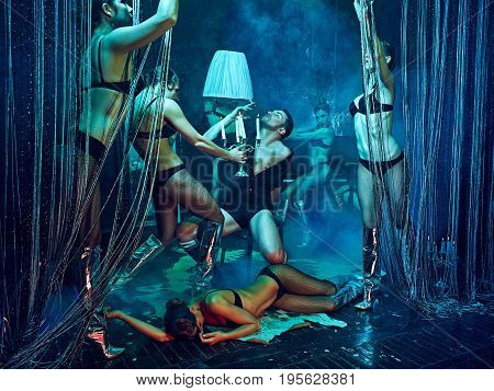 The studio shot of group of dancers dancing at retro costumes. Concept of cabaret, luxury party and jazz
