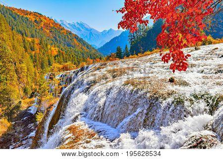 Autumn view of the waterfall with pure water. Jiuzhaigou nature reserve Jiuzhai Valley National Park China