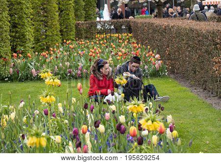 LISSE NETHERLANDS - APRIL 19 2017: Visitors at the Keukenhof Garden in Lisse Holland Netherlands.