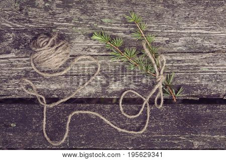 stillife with decorative materials rope and plant on a wooden background