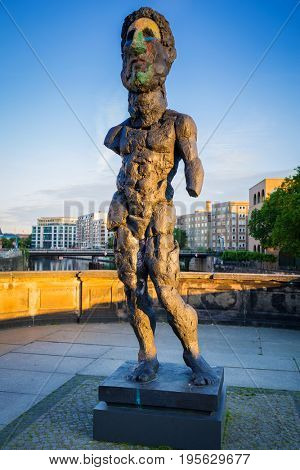 BERLIN, GERMANY - JUNE 15, 2017: Art statue on museum island in Berlin at sunrise, Germany. Berlin is the capital and the largest city of Germany with a population of approximately 3.7 million people.
