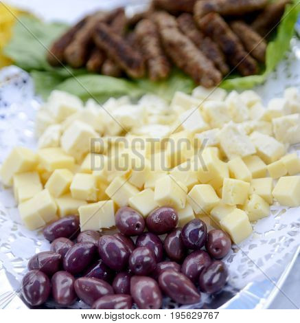 Olives And Clises Of Cheese ,shallow Dof