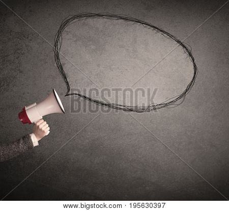 Caucasian business hand holding megaphone with drawn empty speech bubble