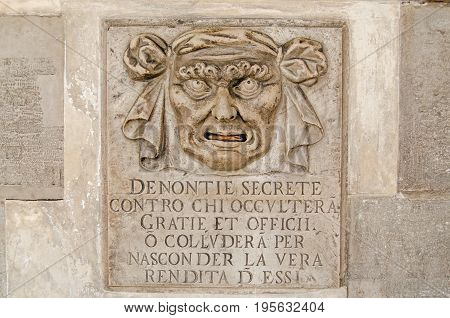 Renaissance stone letterbox on the exterior wall of the Doge's Palace Venice. Citizens could write secret accusations about their fellow City State residents which would be placed through the mouth of the sculpture and considered by the Council of Ten.