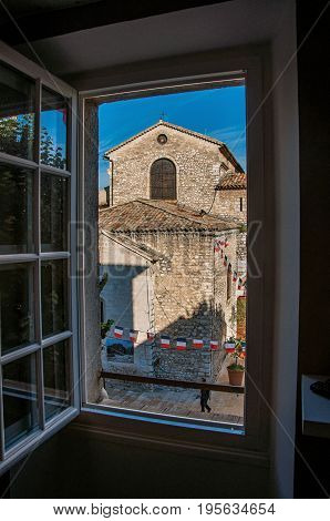 Vence, France - July 13, 2016. Church and steeple with clock in the Vence village, a stunning medieval town completely preserved. In Alpes-Maritimes department, Provence region, southeastern France