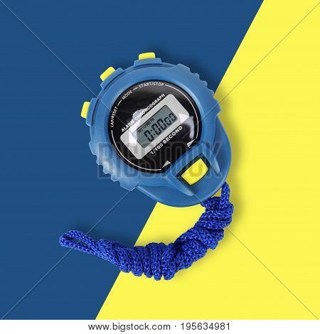Sports equipment - Blue Digital electronic Stopwatch on a on yellow-blue background