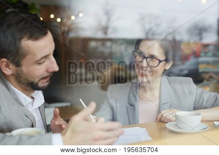 Businessman discussing resume of applicant at interview