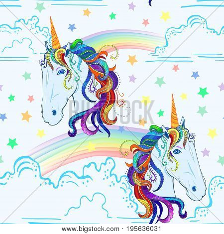 Seamless pattern with unicorn, rainbow, clouds and stars.