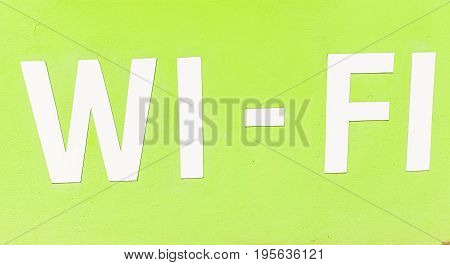 Wi-fi Available here sign. Wi-Fi inscription on green background