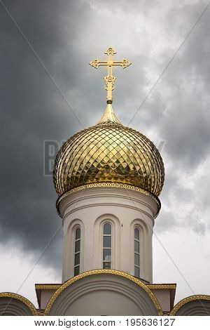 Golden Dome Of The Church In A Stormy Sky.