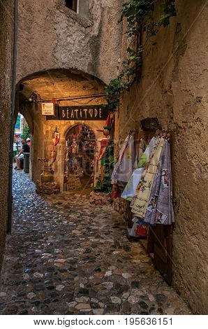 Saint-Paul-de-Vence, France - July 13, 2016. View of narrow alley with shop in the village of Saint-Paul-de-Vence, stunning medieval town completely preserved. In Provence region, southeastern France