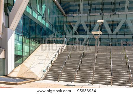 Flight of stairs leading to the entrance of a glass-front building