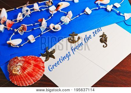 Soft focus vacations and tourism concept with sea shells and tagline