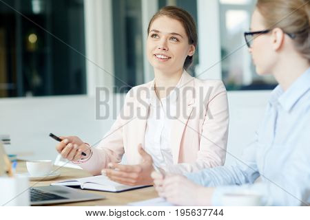 Young manager brainstorming and explaining idea to co-worker
