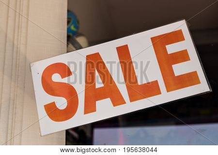 Shop or Store Window With Sale Sign
