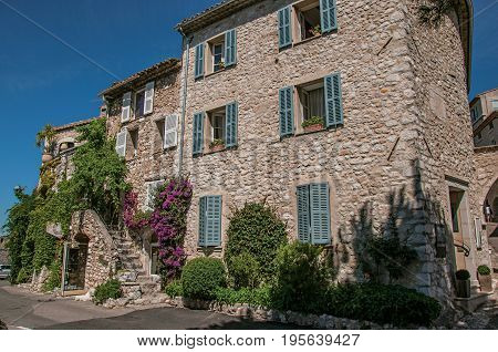 Saint-Paul-de-Vence, France - July 13, 2016. House with staircase and bindweed in the Saint-Paul-de-Vence village, stunning medieval town completely preserved. In Provence region, southeastern France