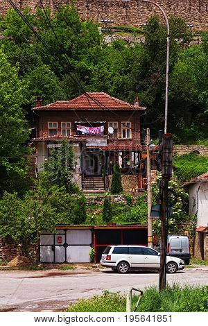 VELIKO TARNOVO BULGARIA - MAY 28 2017: Traditional bulgarian house just down the fortress hill on secondary lane