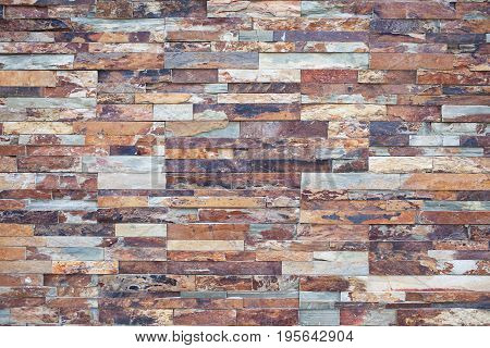 Close-up of stone wall pattern natural surface. Modern and creative interior and exterior walls design. Brick wall building and brick wall decoration texture.