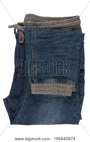 Blue denim jeans pants isolated on white background with copy space for text decoration folded fashion fabric textile pants for wearing. Top view.