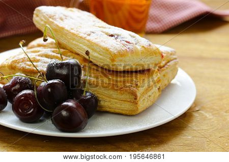 Strudel from puff pastry with cherry filling
