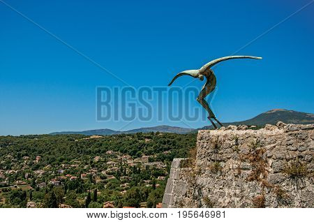 Saint-Paul-de-Vence, France - July 13, 2016. Panoramic view of hills and sculpture in Saint-Paul-de-Vence, stunning medieval village completely preserved. Provence region, southeastern France