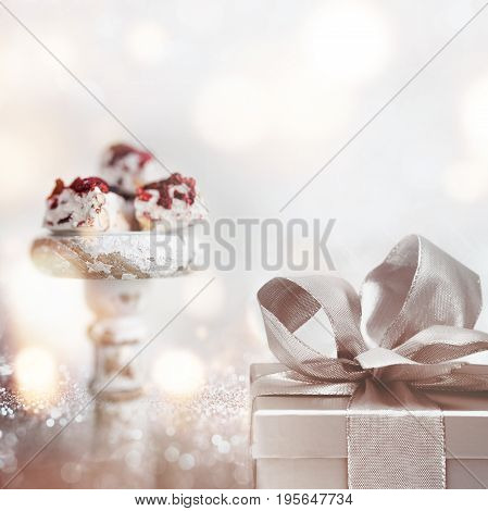 Sweet surprise on a silver bokeh background for a romantic gift