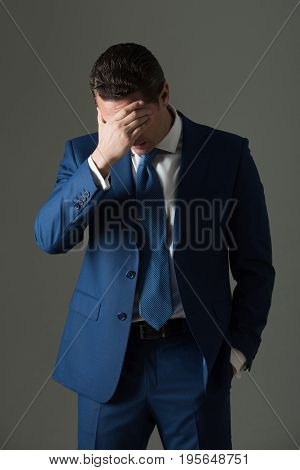 Tired Man Feeling Headache With Stylish Hair In Fashionable Suit