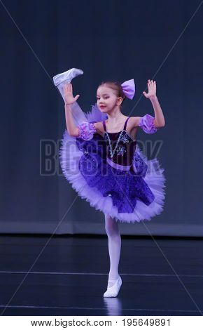 Little girl dancing ballet Coppelia variation on stage