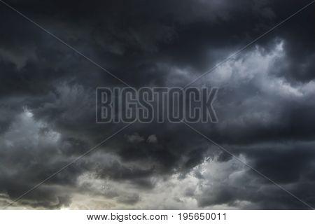 Dark cloud, rain cloud, stormy before rain. gray storm cloud at sunset.