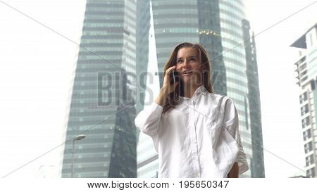 Businesswoman in white shirt got good news, excited happy.