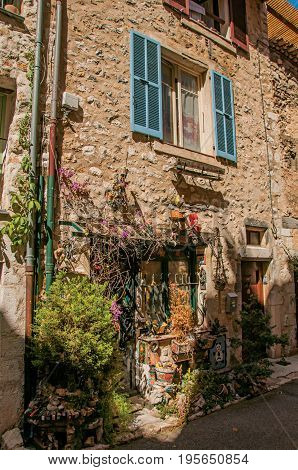 Close-up of door house and plants in Vence, a stunning medieval hamlet completely preserved. Located in the Alpes-Maritimes department, Provence region, southeastern France