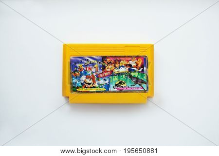 Russia Moscow - 14 July 2017: The original 1996 TV Game cartridge with the Super Mario Jurassic Park games