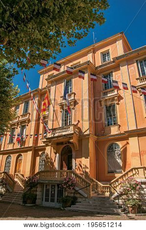 Vence, France - July 13, 2016. View of the city hall's building and flags in Vence, a stunning medieval town completely preserved. In Alpes-Maritimes department, Provence region, southeastern France